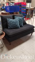 Black two seated couch with blue