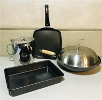 Wok, grilled cheese pan, cake pan and large metal