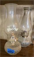Two antique oil lamps