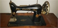 Pedal singer sewing machine with cabinet