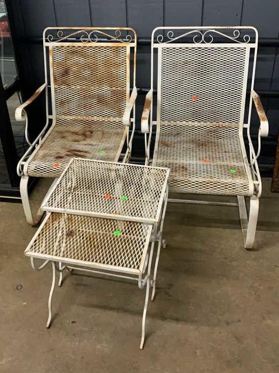 pair of white metal bounce patio chairs