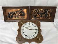 2 copper wall hangings and kitchen clock