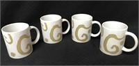 4 Oscar de la Renta coffee mugs