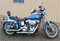 2005 Harley Davidson Dyna Low Rider Motorcycle - This item will be sold at live auction. More info and pics can be found in the catalog.  If unable to attend, you can place a MAX ABSENTEE BID simply by registering to bid, then go to catalog to bid.  Bidding opens 7/4/20, all Max bids must be placed by 6 am 7/18/20.  If you are the winning bidder, you will be notified immediately after the item is sold to make payment and pick up arrangements.