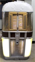 AMI Mdl 500 Juke Box - This item will be sold at live auction. More info and pics can be found in the catalog.  If unable to attend, you can place a MAX ABSENTEE BID simply by registering to bid, then go to catalog to bid.  Bidding opens 7/4/20, all Max bids must be placed by 6 am 7/18/20.  If you are the winning bidder, you will be notified immediately after the item is sold to make payment and pick up arrangements.