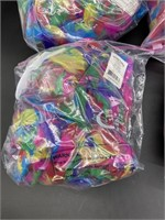 Four bags of colorful feathers