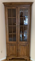 Ethan Allen Co. illuminated corner cabinet