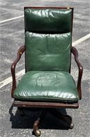 Vinyl green swivel office chair