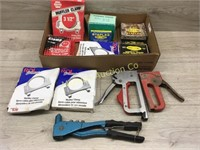 BOX OF STAPLERS STAPLES AND MUFFLER CLAMPS