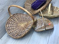 4 WICKER BASKETS AND A BAG OF CROWN BAGS