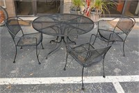 W/I patio table and 4 chairs