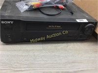 SONY VCR/ BOX OF CABLES/ RADIO