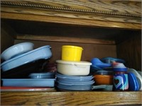 Lot of plastic containers and tops