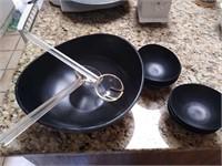 Large black plastic serving set