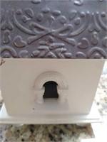 Decorative white wooden birdhouse