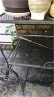 Outdoor iron cart and contents