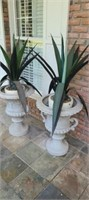 pair of plastic plant holder with faux plants