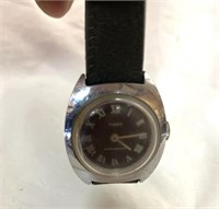 Mini Timex winter resistant watch with a little