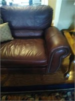Leather like reclining couch with studs