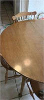 beautiful wood circle dining table and 4 chairs