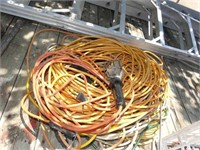 Group of Extension Cords and Trouble Light