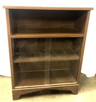 Wooden shelving unit with two glass doors