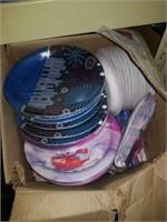 Box of holiday plates and knapkins