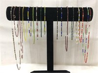 Lot of vintage beaded necklaces-Display stand not