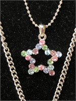 Three vintage costume jewelry necklaces including