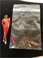 Vintage pin and a dream catcher necklace