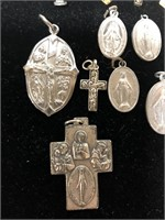 Religious charms and pins