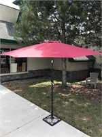 Large 8 ft red patio umbrella on metal stand