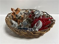 Basket of metal and plastic cookie cutters