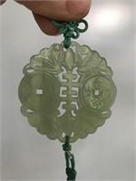 Asian inspired carved medallion
