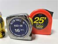 Four measuring tapes