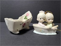 Precious Moments and cradle porcelain figurines
