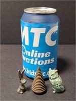 Three tiny cast metal trinkets