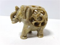 Carved stone pregnant elephant figure