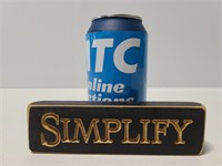 "Wood ""simplify"" block sign"