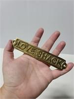 "Brass ""Love Shack"" emblem"