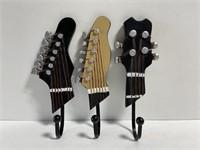 Lot of 3 guitar head wall hooks