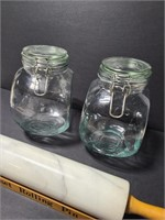 Two kitchen canisters and marble rolling pin