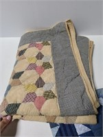 Two small machine made quilts