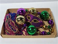 Mardi Gras beads and mask