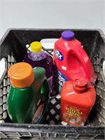 Crate with cleaning products and lighter fluid
