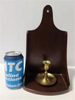 Wood wall shelf with brass candlestick