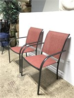Pair of metal patio chairs w/ red mesh seats