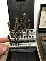 Drill bits and hole saw bits in metal cases