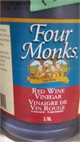 Two jugs red wine vinegar