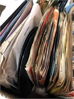 Box of vintage vinyl 45 rpm records